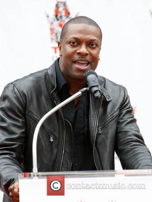 Chris Tucker - Jackie Chan is honoured with a hand and foot print ceremony at the TCL Chinese Theatre in...