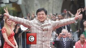 Jackie Chan - Jackie Chan is honoured with a hand and foot print ceremony at the TCL Chinese Theatre in...