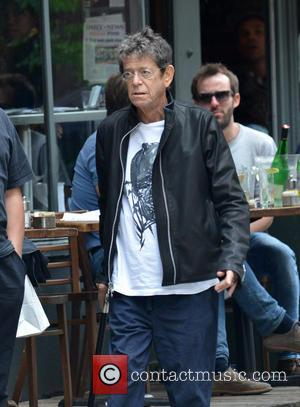 Lou Reed - Lou Reed, who recently had a liver transplant, leaves a restaurant in the West Village using a...