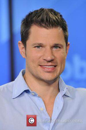 Nick Lachey - Nick Lachey and Justin Jeffre of 98 Degrees appear on Global Toronto's 'The Morning Show' - Toronto,...