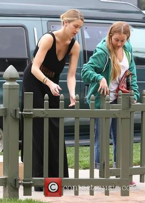 Whitney Port - Whitney Port carrying a large box as she stops at a friend's house in West Hollywood -...
