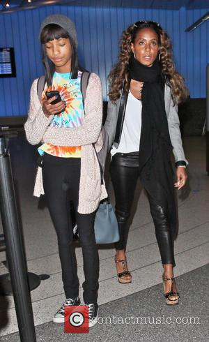 Jada Pinkett Smith and Willow Smith - Celebrities arriving at LAX Airport - Los Angeles, California, United States - Friday...