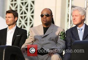 Ryan Seacrest, Stevie Wonder and President Bill Clinton