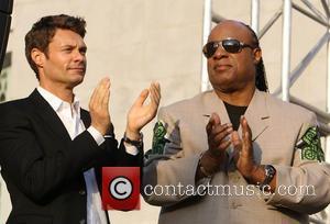 Ryan Seacrest and Stevie Wonder