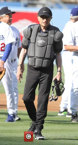 Larry King - Billy Crystal and Larry King take part in the Old Timers game before the Atlanta Braves and...