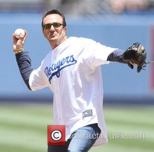Hank Azaria - Hank Azaria throws out the first pitch at Dodger Stadium - Los Angeles, CA, United States -...