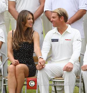 Elizabeth Hurley and Shane Warne - Elizabeth Hurley and Shane Warne host a cricket match between an Australian 11 and...