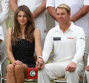 Elizabeth Hurley Splits From Shane Warne Over Twitter, Sort Of