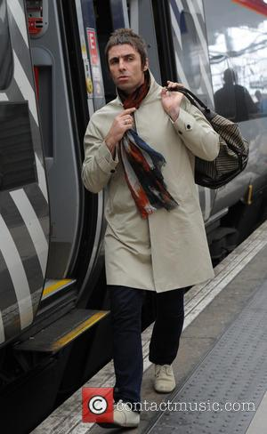 Step Off A Train, All Alone at Dawn: Liam Gallagher Returns To Manchester [Pictures]