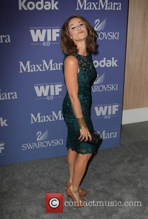 Amy Brenneman - Women In Film's 2013 Crystal + Lucy Awards at The Beverly Hilton Hotel - Los Angeles, California,...