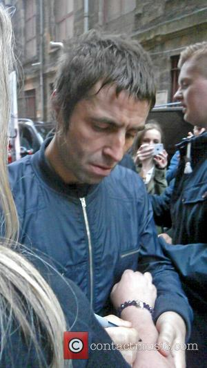 Liam Gallagher - Liam Gallagher seen outside the HMV Glasgow posing with fans after the Beady Eye in-store signing and...