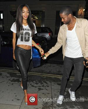 Jourdan Dunn - Jourdan Dunn arrives at St Martins Lane Hotel with a smile on her face and clutching a...