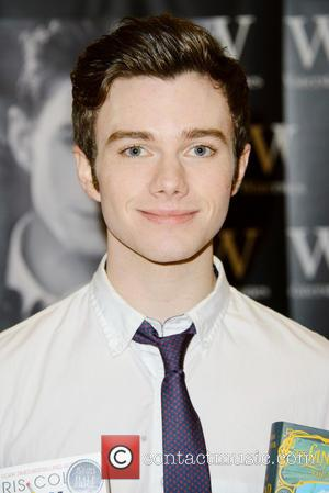 Chris Colfer signs copies of his books 'The Land of Stories: The Wishing Spell and Struck by Lightning' at Waterstones...