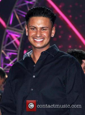 "Las Vegas Fling Results In Unexpected Baby Girl For ""Jersey Shore's"" Pauly D"