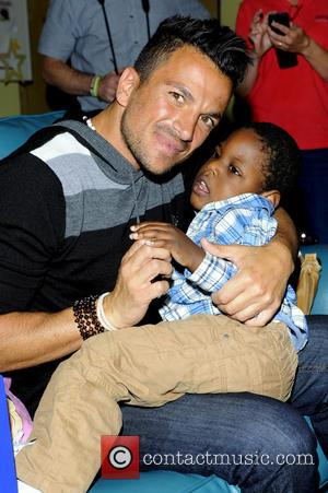 Peter Andre and Elijah Hyde - Peter Andre and Karen Millen - hospice visit Ahead of next month's festival Music...