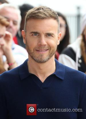 Gary Barlow's Charity Work Enough to Retain OBE, Insists David Cameron