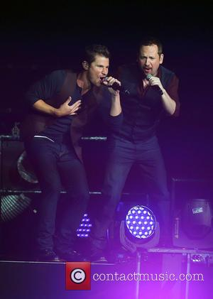Nick Lachey, Justin Jeffre and 98 Degrees - 98 Degrees perform live in concert during 'The Package Tour' at the...