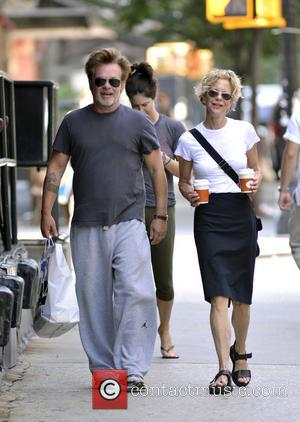 John Mellencamp and Meg Ryan - Meg Ryan carries some drinks while out for a stroll in Manhattan with John...