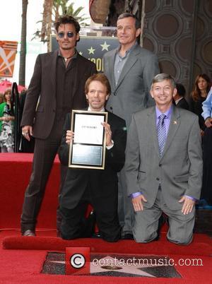 Johnny Depp, Bob Iger, Jerry Bruckheimer and Leron Gubler
