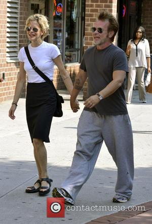 John Mellencamp and Meg Ryan - John Mellencamp and Meg Ryan holding hands while out for a stroll in Manhattan...