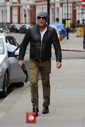 Mickey Rourke - Mickey Rourke seen leaving Scott's Restaurant in Mayfair - London, United Kingdom - Tuesday 25th June 2013