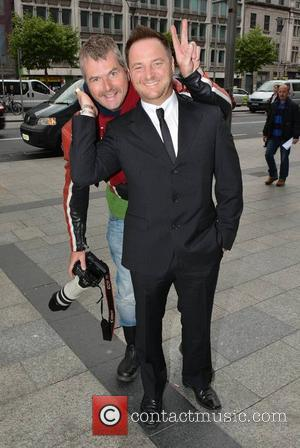 Mikey Graham and photographer - Guests arrive at the Irish Premiere for 'Now You See Me' at The Savoy -...