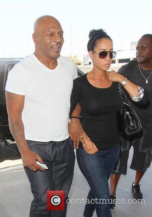 Mike Tyson and Lakiha Spicer - Mike Tyson and Wife Lakiha Spice are seen arriving at LAX Airport. - Los...