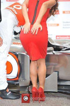 Jenson Button and Myleene Klass - Myleene Klass and Jenson Button pose for pictures with a McClaren car to promote...