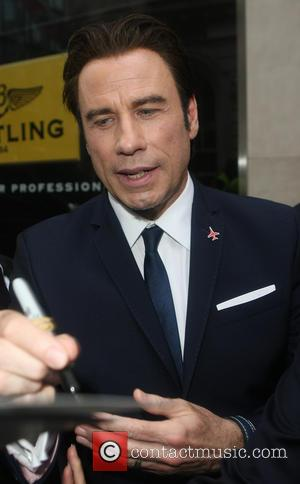 John Travolta - Breitling London store launch held at New Bond Street - Departures - London, United Kingdom - Thursday...