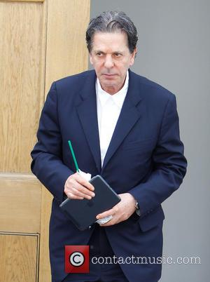Charles Saatchi - Charles Saatchi seen at the family home in Chelsea as furniture removal men load items into a...