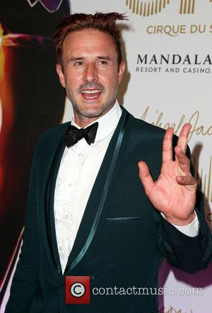 David Arquette Skydives Topless