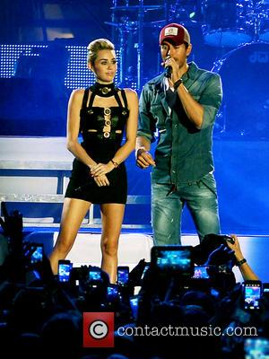 Miley Cyrus and Enrique Iglesias