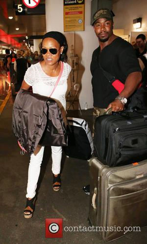 Robin Givens - Michael Jai White and Robin Givens arrive at LAX airport on a flight - Los Angeles, California,...