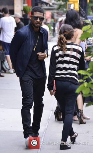 Usher and Usher Raymond IV - Usher leaving his Manhattan hotel to go to his Empire State Building lighting ceremony...