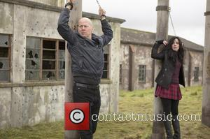 BRUCE WILLIS and MARY-LOUISE PARKER - Still images from upcoming action-comedy 'Red 2' (2013), starring Bruce Willis, Helen Mirren and...