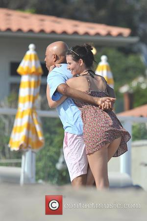 Russell Simmons and Hana Nitsche - Russell Simmons and his girlfriend, german model Hana Nitsche, spotted having fun in Malibu...