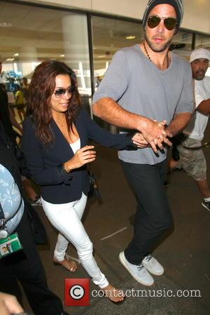 Eva Longoria and Ernesto Arguello - Eva Longoria with boyfriend Ernesto Arguello seen arriving at LAX Airport - Los Angeles,...