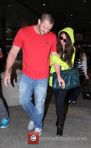 Selena Gomez and Brian Teefey - Selena Gomez arrives at LAX Airport on a flight in from Europe accompanied by...