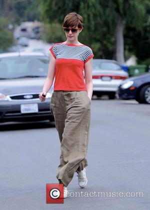 Anne Hathaway - Anne Hathaway was all smiles while walking to a friends house wearing big baggy trousers - CA,...