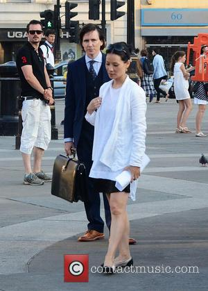 Jonny Lee Miller and Lucy Liu - Lucy Liu and Jonny Lee Miller filming on 'Elementary' on location in Trafalgar...