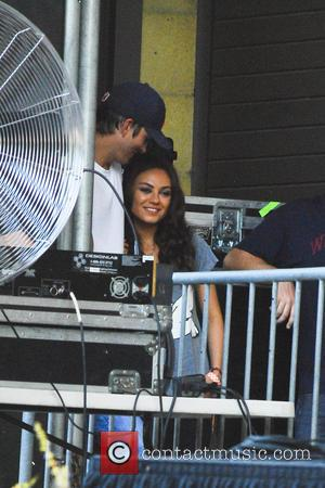 Ashton Kutcher and Mila Kunis - Ashton Kutcher and girlfriend Mila Kunis spotted at the Taste of Chicago Concert -...