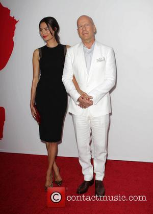 Emma Heming and Bruce Willis - Los Angeles premiere of 'RED 2' held at the Village Theatre - Los Angeles,...