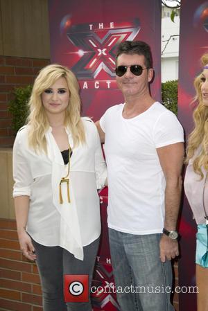 Demi Lovato and Simon Cowell