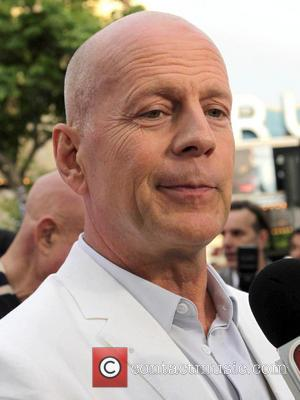 Bruce Willis - Los Angeles premiere of 'RED 2' held at the Village Theatre - Arrivals - Los Angeles, California,...