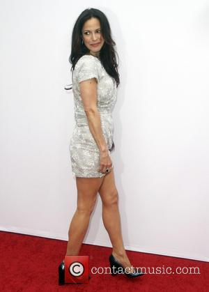 Mary-Louise Parker - Los Angeles premiere of 'RED 2' held at the Village Theatre - Arrivals - Los Angeles, CA,...