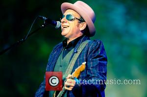 Elvis Costello And The Roots Form Unlikely Alliance For 'Wise Up Ghost'