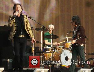 Charlie Watts, Mick Jagger, Ronnie Wood and The Rolling Stones