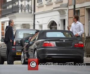 Mario Testino - Fashion photographer Mario Testino with a male companion arrives at the Dorchester. Mario is reportedly photographing the...