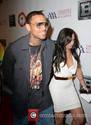Chris Brown - Chris Brown and a female friend walk the red carpet at the All-Star Celebrity Kickoff party for...