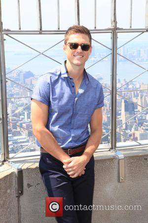 Aaron Tveit - 'Graceland' star Aaron Tveit poses at the Empire State Buildling in Manhattan - New York , NY,...